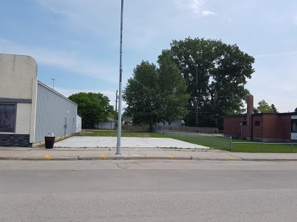 1024 Main Street - Lot 03 Block 09 - Commercial Serviced Lot - 40 x 125 C/W Cement Pad - Must Build Before Title Transfer